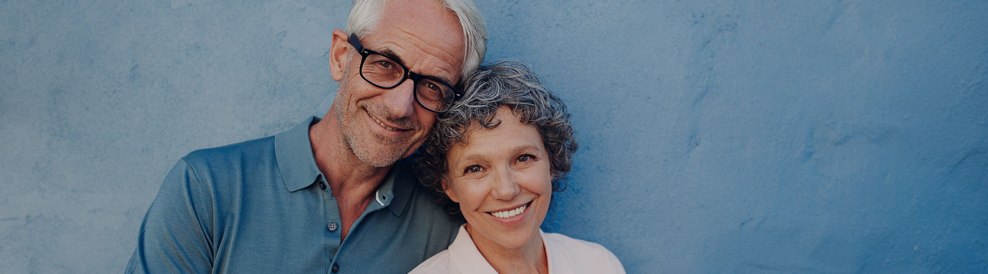 mature couple wearing glasses