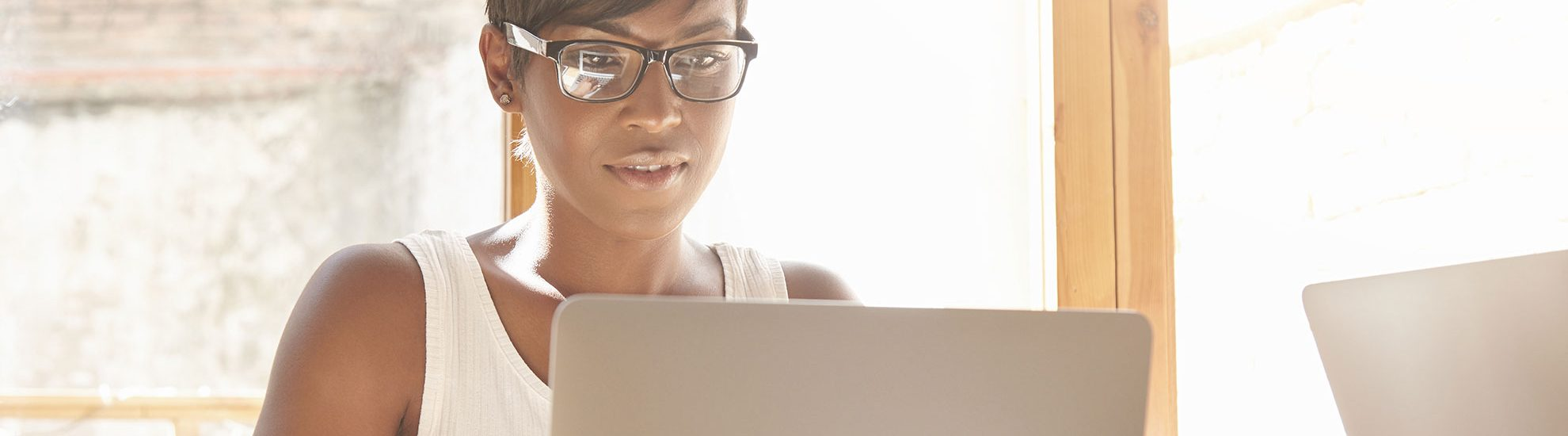 Woman wearing glasses using a computer